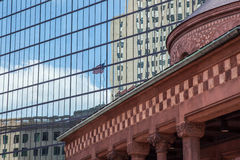 Boston Strong. Boston Flag captured reflecting off building Stock Image
