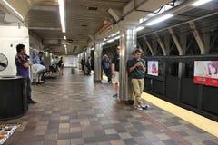 Boston subway. BOSTON, USA - JUNE 8, 2013: People wait for MBTA subway train in Boston. 165 million subway rides were served by MBTA in 2012 Royalty Free Stock Photos