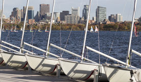 Boston. A sunny day in Boston, Massachusetts, USA showcasing the architecture of its Financial District and the Charles River with people having fun sailing boat stock image