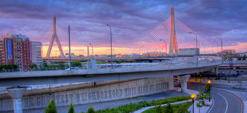 Boston Sunrise Zakim Bridge. Sunrise view of Boston's Leonard P. Zakim Bunker Hill Bridge from the highway onramp on Nashua Street in the West End Park Stock Images