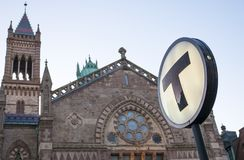 Boston. The symbol of transportation in Boston, MA, USA. The T sign in front of a historic church at Copley Square at night Stock Photo