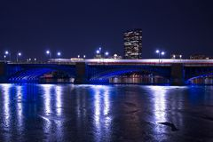 The Boston red T moving across a bridge over the frozen Charles river. royalty free stock photo