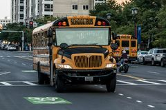 BOSTON UNITED STATES 05.09.2017 - typical American yellow school bus drinving in the center of the city of Boston. BOSTON UNITED STATES 05.09.2017 -typical stock images