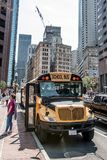 BOSTON UNITED STATES 05.09.2017 - typical American yellow school bus drinving in the center of the city of Boston. BOSTON UNITED STATES 05.09.2017 -typical royalty free stock images