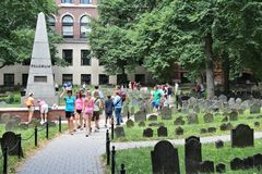 Granary Burying Ground. BOSTON, USA - JUNE 9, 2013: People visit Granary Burying Ground in Boston. The cemetery is 3rd oldest in Boston, founded in 1660 royalty free stock photography