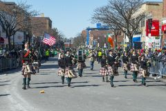 Military Bagpipers in Saint Patrick's Day parade Boston, USA. BOSTON, USA - Mar. 18, 2018: Military Bagpipers in Saint Patrick's Day Parade in Boston royalty free stock photos