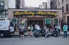Locals gathering in front of the famous Mike`s Pastry in North End. Boston, USA - May 28, 2016: View of locals gathering in front of the famous Mike`s Pastry in stock images