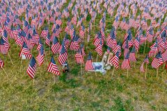 Thousands of US flags planted in Boston Common, to commemorate fallen soldiers in wars, during Memorial Day weekend stock photo