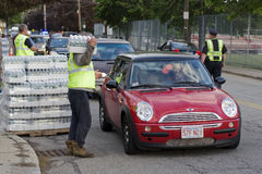 Boston Water Ban 2010. Watertown, MA Watertown Department of Works hands out free cases of water to residents after 2 days of a city wide water boil order Stock Photography