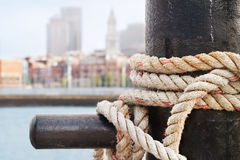 Boston Waterfront from Charlestown. Heavy ropes secure a ship on the Charlestown side of Boston Harbor Stock Photo