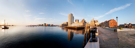 Boston waterfront in early morning sun. Morning sun lights up Boston Harbor and the downtown waterfront. Taken from the end of Long Wharf Royalty Free Stock Photo