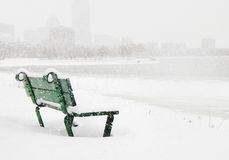 Boston winter. Bench in the snow on Charles River in Boston Royalty Free Stock Photo