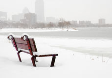 Boston winter. Bench in the snow on Charles River in Boston Royalty Free Stock Image