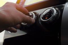 Botão da rotação da condição do ar no carro fotografia de stock