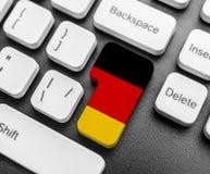 Botão da tecla enter com a bandeira de Alemanha Imagens de Stock