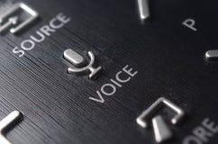 Botão da voz no telecontrole da tevê Imagens de Stock