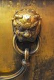 Botão de bronze imagem de stock