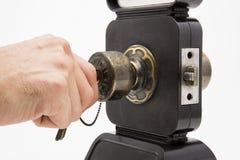 Botão de porta de alumínio no fundo preto do branco da porta fotos de stock royalty free