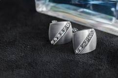 Botão de punho de prata com pedras preciosas Fotografia de Stock