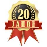 Botão do jubileu com bandeira e fitas por 20 anos Foto de Stock Royalty Free