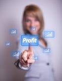 Mulher que pressiona o botão do lucro foto de stock royalty free