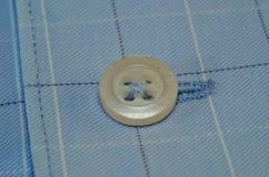 Botão macro em sua camisa Foto de Stock Royalty Free