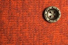 Botão no fundo de matéria têxtil Copie o espaço foto de stock royalty free