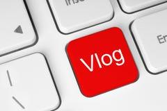 Botão vermelho com palavra de Vlog no teclado imagem de stock