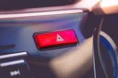 Botón amonestador rojo empujado con el pictograma del triángulo y el li el interruptor intermitente Fotografía de archivo