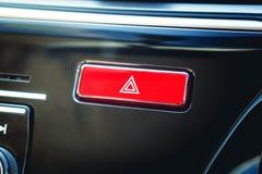 Botón amonestador rojo empujado con el pictograma del triángulo y el li el interruptor intermitente Fotos de archivo libres de regalías