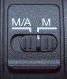Botón auto y mannual de la lente del foco Fotografía de archivo