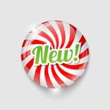 Botón brillante con espiral y texto NUEVO Foto de archivo libre de regalías