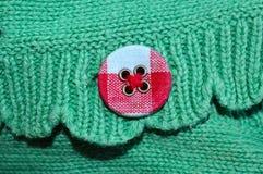 Botón coloreado hermoso cosido encendido imágenes de archivo libres de regalías