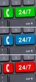 Botón con 24/7 símbolo e icono del teléfono móvil Imagen de archivo