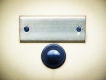 Botón de alarma y letrero viejos Imágenes de archivo libres de regalías