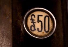Botón de cincuenta libras imagen de archivo libre de regalías