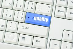 Botón de la calidad Foto de archivo libre de regalías