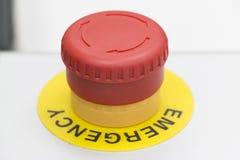 Botón de la emergencia del color rojo Fotografía de archivo libre de regalías