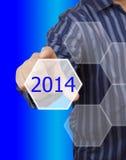 Botón de la pantalla con el número 2014 a mano. Fotografía de archivo