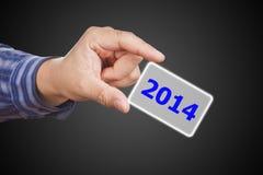 Botón de la pantalla con el número 2014 a mano. Imagen de archivo