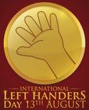 Botón de oro con la mano izquierda para los zurdos internacionales día, ejemplo del vector Fotografía de archivo libre de regalías