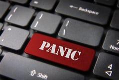 Botón de pánico rojo de la llave de teclado, fondo de la situación Imagen de archivo libre de regalías