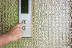 Botón de plata del elevador del presionado a mano Imágenes de archivo libres de regalías