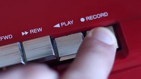 Botón de registro en la grabadora