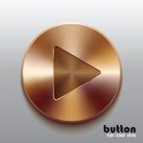 Botón de reproducción de bronce Fotos de archivo