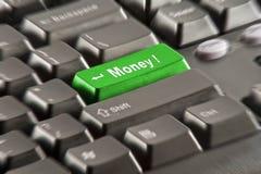 Botón del dinero en un teclado negro Imagen de archivo libre de regalías
