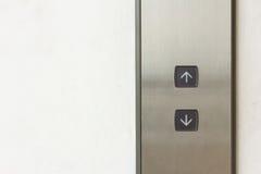 Botón del elevador arriba y abajo de la dirección Fotografía de archivo libre de regalías