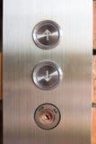 Botón del elevador arriba y abajo de la dirección Foto de archivo libre de regalías