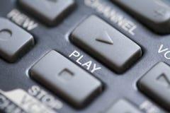 Botón del juego en el telecontrol Fotos de archivo libres de regalías