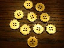 Botón del oro Fotografía de archivo
